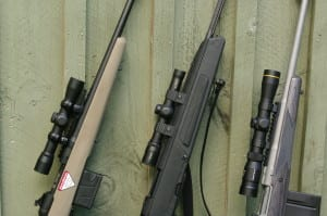 Scout rifles are defined by forward mounting the scope. L to R: Weaver, Burris & Leupold.