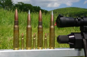 .50 BMG cartridges with .223 Remington.