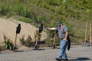 I am shooting multiple targets while on the move, with no sights on my Sig Sauer 320 pistol.
